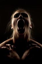 Portrait Of Screaming Woman In...