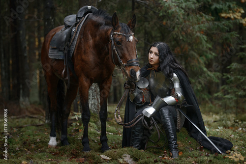 Portrait of beautiful medieval girl warrior in a chain mail hood. Fototapete