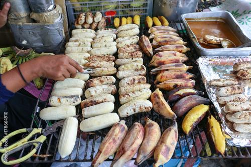 Photo  Local seller make Roasted Pisang Awak banana and  musa silver bluggoe banana at