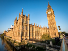 Big Ben And The Palace Of Westminster. Low Angle View Of The Famous Clock Tower London Landmark In The Early Morning Sun.