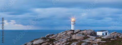 Foto op Aluminium Vuurtoren Working Lighthouse at Northern Spain in Bad Weather