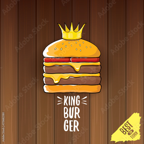vector cartoon royal king burger with cheese and golden crown icon isolated on on wooden table background.