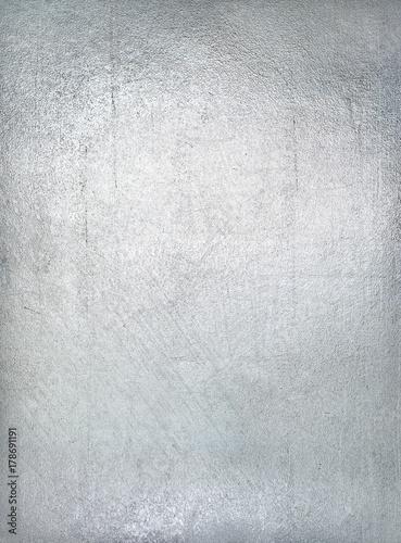 Fotografía  Worn metal plate steel background. Silver foil.