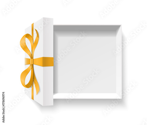 Empty open gift box with gold color bow knot and ribbon isolated on white background Canvas Print