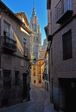 Narrow Street Opening To A High Cathedral