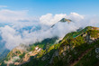 Aerial view of mountains and clouds from the top of mountain in Rosa Khutor, Russia