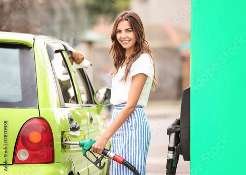 Photo  Woman refueling car on petrol station