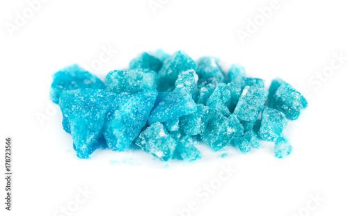Blue crystal of methamphetamine isolated on white background Wallpaper Mural