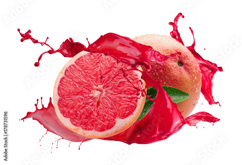 grapefruits with juice splash isolated on a white background