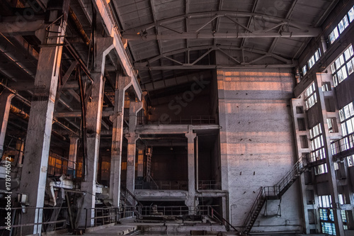 Aluminium Prints Old abandoned buildings Dark industrial interior of large empty hall for manufacturing or warehousing. Abandoned factory