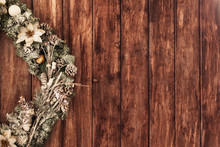 Beautiful Green Christmas Wreath With White Flowers Hang On Wood