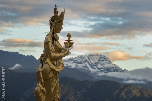 Fotografie, Obraz  Goddess Statue near the Dordenma Golden Buddha, Thimphu with Himalayan peaks in the background