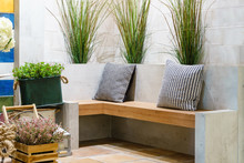 Relax Corner In Home Garden With Wood Chair And Concrete Wall Background
