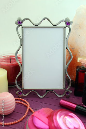 A romantic frame mock-up with feminine accessories in pink and ...