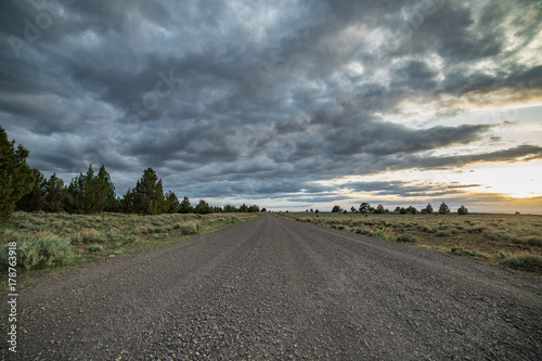 Fotografie, Obraz  Dramatic empty gravel road into the unknown