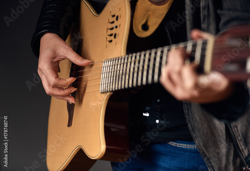 Fotografering  Close-up of woman hands with guitar