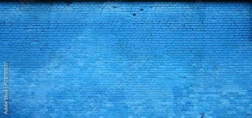Photo sur Toile Brick wall The texture of the brick wall of many rows of bricks painted in blue color