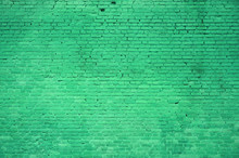 The Texture Of The Brick Wall Of Many Rows Of Bricks Painted In Green Color