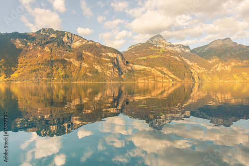 Foto auf Gartenposter Reflexion Mirror reflection in autumn. Autumn. Mountains and clouds are reflected in the water of Lake Lucerne. Canton of Uri, Switzerland.