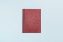 Red Book On The Blue Background.