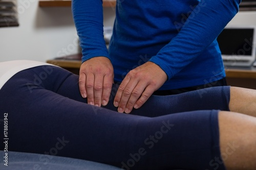 Fototapety, obrazy: Physiotherapist giving leg massage to a woman