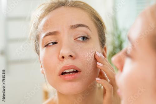 Cuadros en Lienzo Young beautiful woman touching skin in bathroom