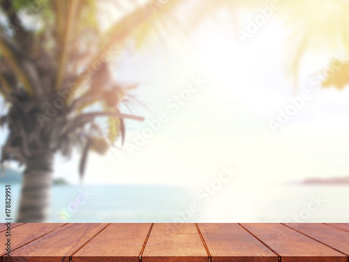Foto auf Gartenposter Strand Empty wooden table blurred tree coconut and blue sky