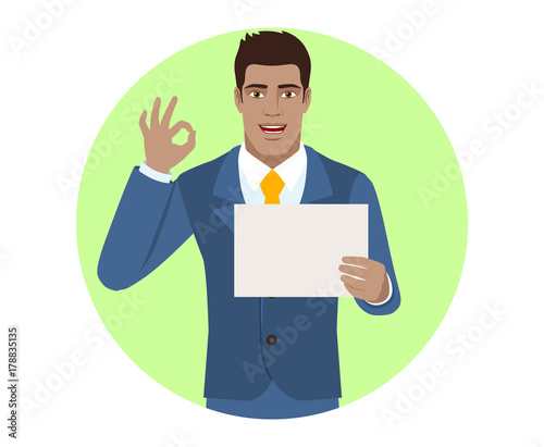Businessman showing a a paper and  show a okay hand sign Canvas Print