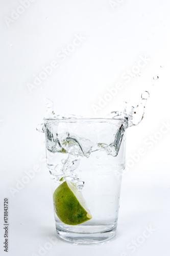 Poster Opspattend water Water motion lemon on white background