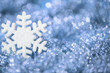 Snowflake Blue Background, Sparkling Snow Flakes Decoration over Defocused Lights Background