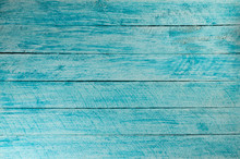 Painted In Blue And White Color Wall With Wooden Planks.