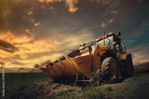 Fényképezés  Yellow tractor on sky background