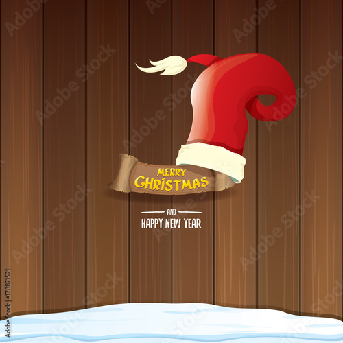 Fototapety, obrazy: vector red Santa hat with paper banner and greeting text Merry Christmas and Happy new year on wooden background.