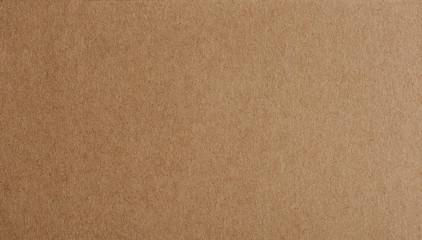 Flat brown paper background closeup