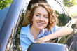 Young businesswoman sitting in car