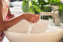 Children Washing Hand Under Fa...
