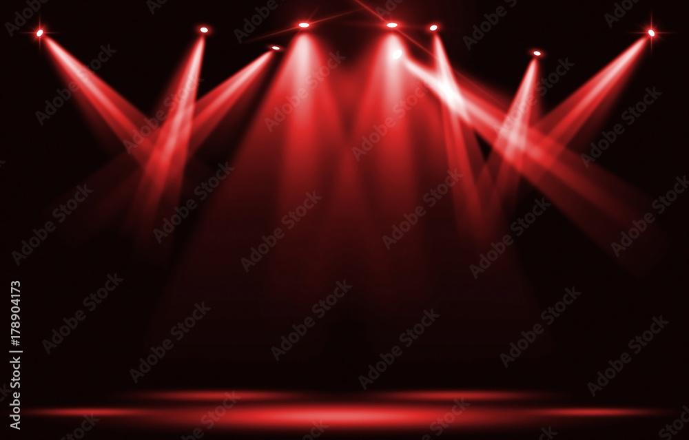 Fototapeta Stage lights. Red spotlight strike through the darkness.