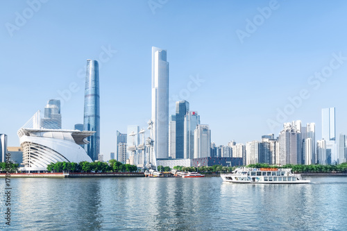 White tourist boat sailing along the Pearl River in Guangzhou