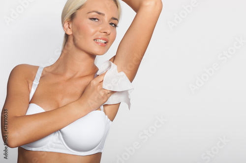 Young woman clean the armpit with wet wipes - Buy this stock photo ... 406e29777