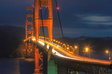 Fototapeta Mosty Golden Gate Bridge close up at night, San Francisco, California.