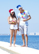 Young couple on beach. Christmas concept