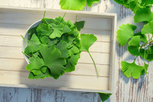 Medicinal Leaves From The Ginkgo Biloba Tree From China. Ginko Biloba Leaf On An White Vintage Table. View From Above.