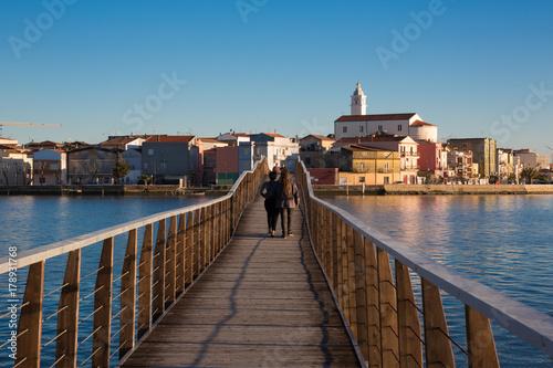 In de dag Milan Lesina (Puglia, Italy) - Lesina Lake, the bridge between the lake and archaelogical site of San Clemente island