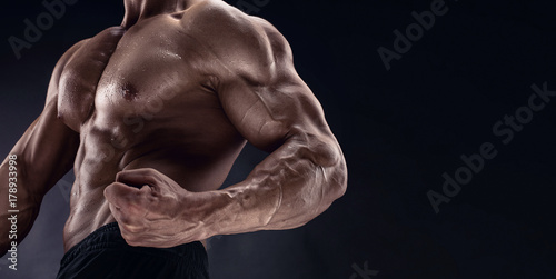 man bodybuilder showing muscular body Fototapeta