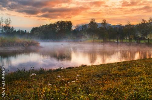 Fotobehang Landschap Misty foggy morning sunrise on the Alpine lake