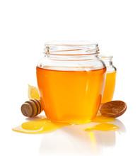 Glass Jar Full Of Honey And Di...