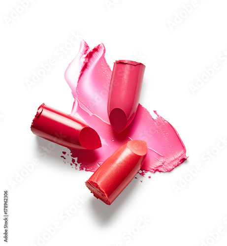 Lipsticks and lipstick smear isolated on white background Wall mural