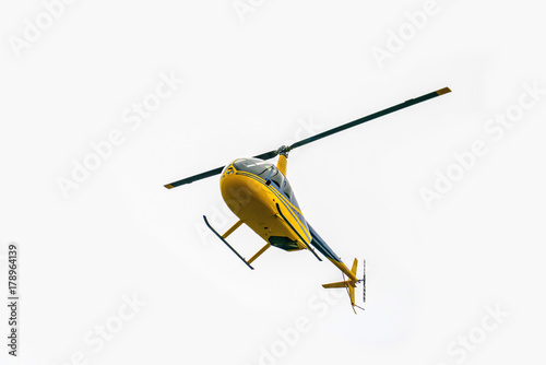 Staande foto Helicopter Yellow helicopter takes off. Air transport in the sky. Aircraft emergency help. The Golden Ring Helicopter Tour