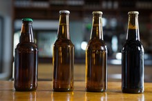 Arranged Beer Bottles On The B...