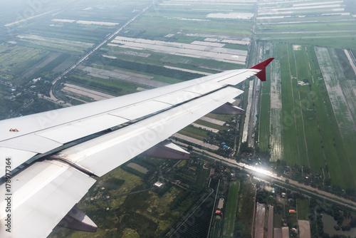 Spoed Foto op Canvas Stadion Airplane wing in the sky